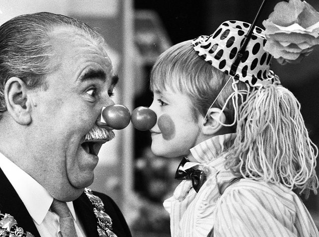 Nice to nose you.....Wigan mayor Councillor Jimmy Jones comes face to face with five-year-old Gary Edwards at Wood Fold Primary School, Standish, for Red Nose Day in aid of Comic Relief on Friday 5th of February 1988.