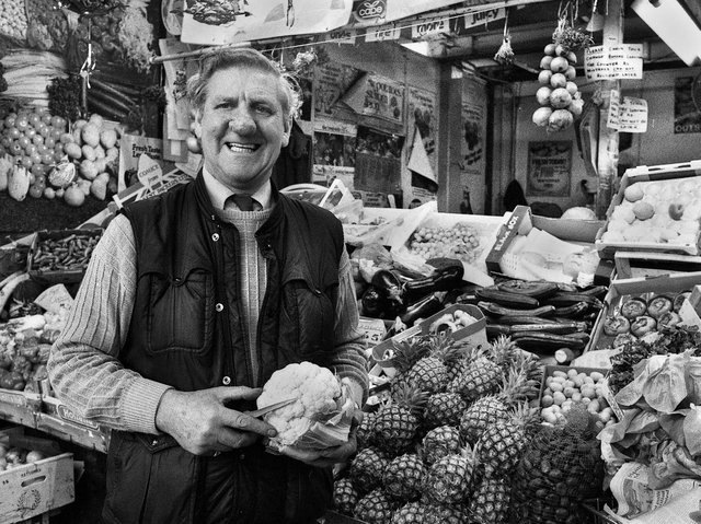 Ken Hall on his fruit and vegetable stall in the old Wigan market hall in December 1987.