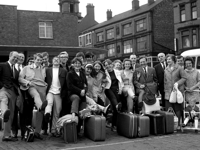 All smiles as Wiganers get ready to board coaches to the seaside during the annual wakes weeks holiday July 1969