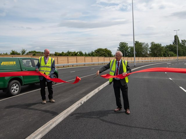 Jones Bros managing director John Dielhof (left) and Leader of Wigan Council, Coun David Molyneux perform the A49 link road opening