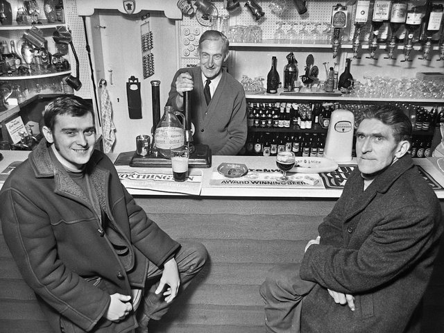 Tontine's Delph Tavern landlord, John Curtis, with customers, Tony Wilkinson and Thomas Glover, in March 1972.