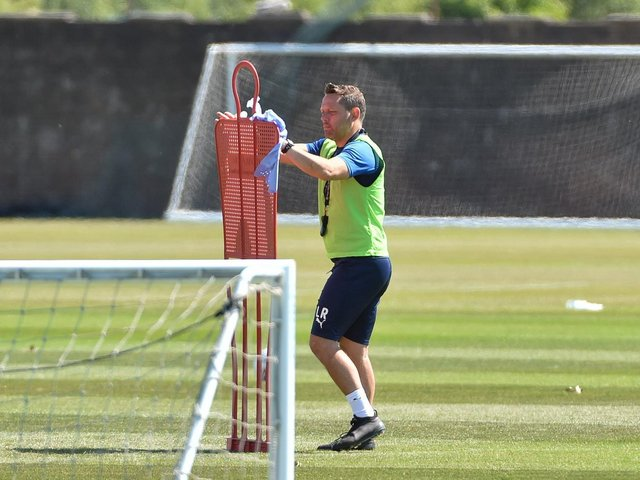 Leam Richardson, Paul Cook's former assistant, wipes down equipment when the squad returned after the lockdown in early summer. He will take charge of training