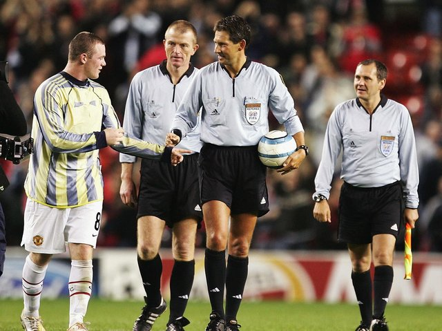 Wayne Rooney tries to get the matchball from the referee after a hat-trick on his debut during the Champions League Group D match between Manchester United and Fenerbahce at Old Trafford on September 28, 2004