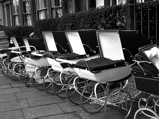A line of prams parked outside St Andrew's Family Clinic, Wigan, in 1967
