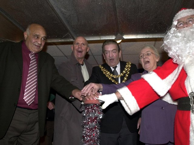 Switching on the Wigan Christmas lights are Wigan rugby legends Billy Boston and Mike Gregory, The Mayor and Mayoress Councillor Wilf and Mrs Agnes Brogan with Father Christmas in 2003.