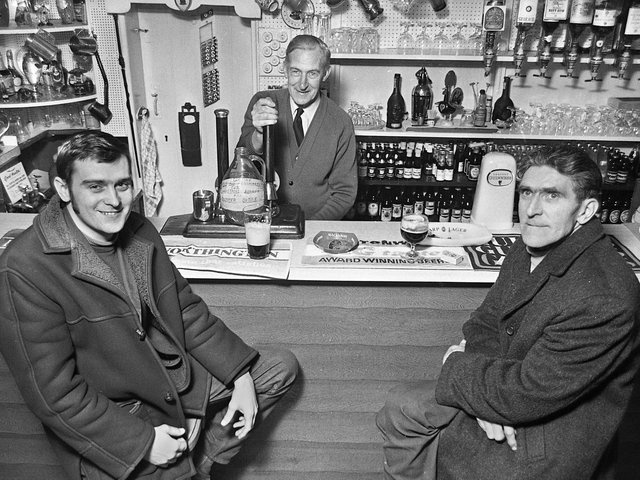 John Curtis, centre, landlord of Tontine's Delph Tavern, with customers, Tony Wilkinson and Thomas Glover, in March 1972.