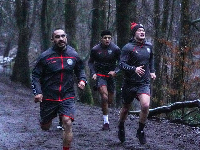 Morgan Smithies (right) running in Haigh Hall