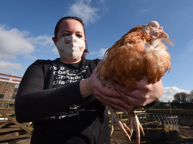 Hazel McGuinness with one of the hens