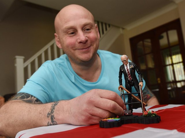Neil Westergren is raising money for the NHS by auctioning the action figure of Captain Tom