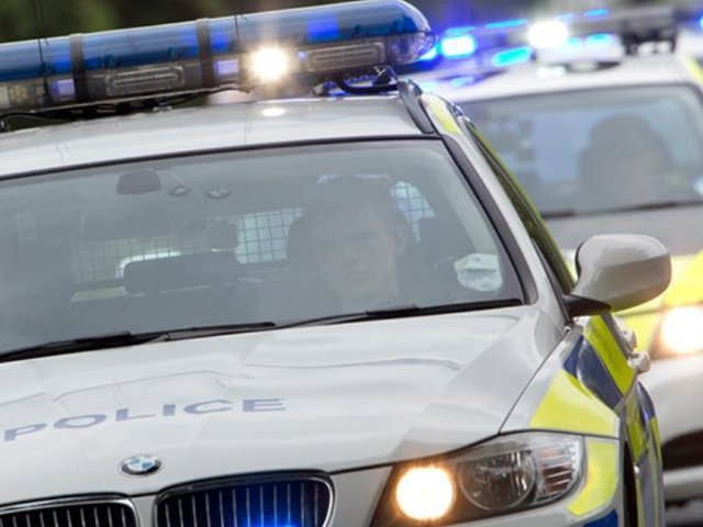 Traffic officers have arrested a man after tailing two trucks that were stolen from Wigan