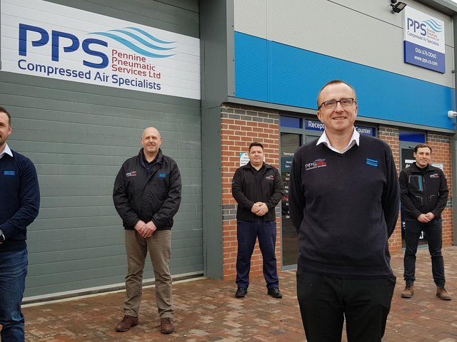 Staff outside the new PPS branch in Leigh