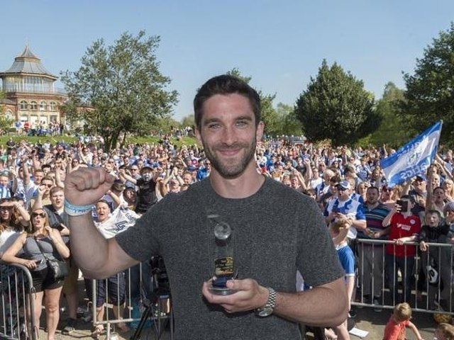 Will Grigg celebrates in Mesnes Park with the Latics fans