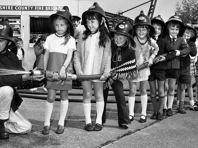 Primary school pupils enjoy a trip to Hindley Green Fire Station in 1971.