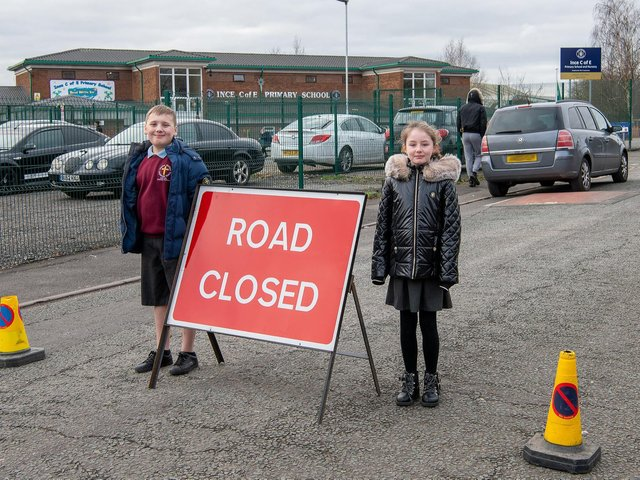 Ince CE Year 5 pupils Jayden-Kai and Darcie with a message to motorists