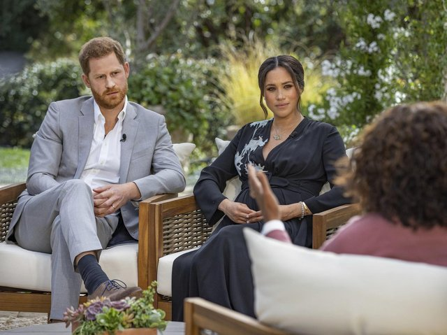 The Duke and Duchess of Sussex talking to Oprah Winfrey