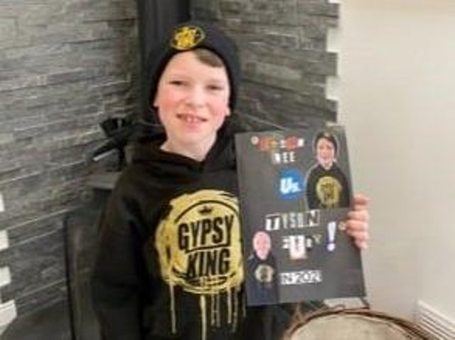 Ethan Lee with his book about Tyson Fury