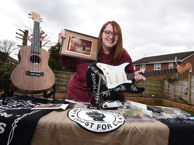 Sarah Hardman with some of the items in the music-themed raffle