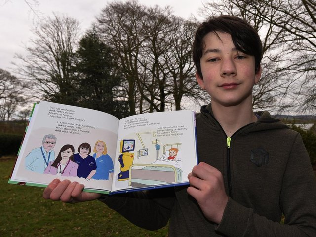 Sam Grant with his children's book about type one diabetes