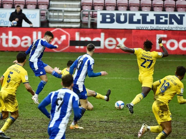Jamie Proctor scores his first goal for Latics against Wimbledon