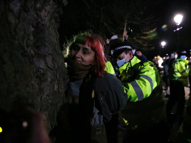 A woman is arrested during a vigil for Sarah Everard on Clapham Common on March 13, 2021 in London