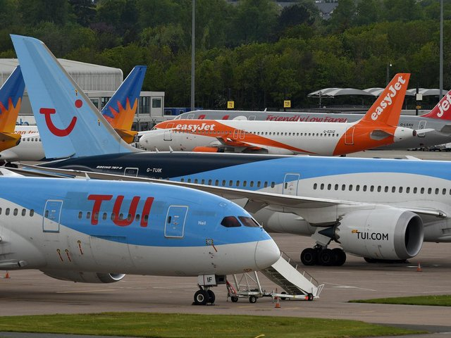 Planes at Manchester Airport. Photo by Getty Images