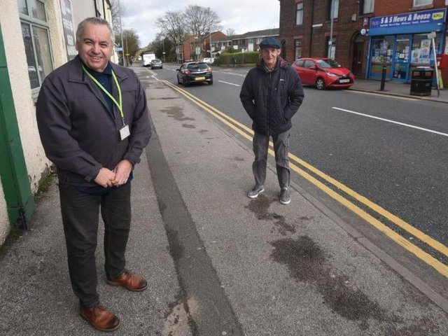 Coun Paul Blay and Coun Jim Talbot next to the busy road