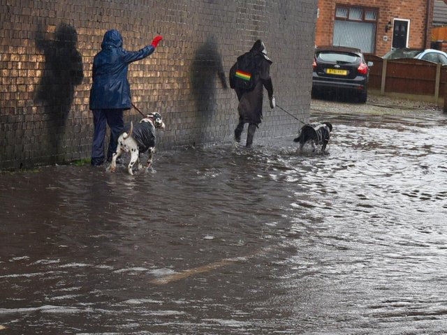 The road and pathway flooded on Buckley Street, Wigan, after heavy rainfall after Storm Christoph hit the borough.