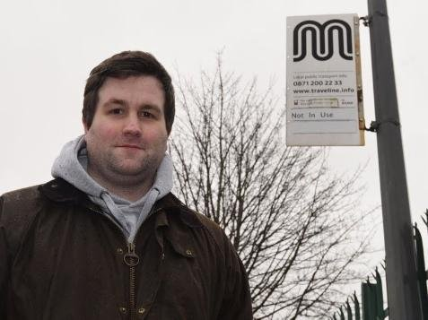 Coun Adam Marsh at a bus stop that is not in use on Bradley Lane, Standish