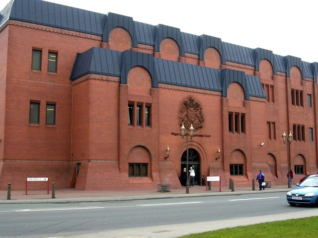 The men will appear before Wigan magistrates tomorrow