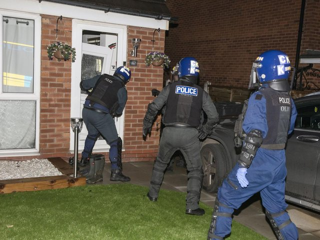 Police executing a warrant at a Wigan home on Tuesday