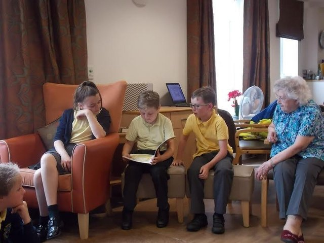 Primary school children share their love of reading at Belong care village