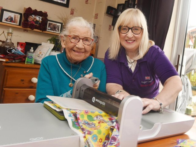 Barbara Kennedy and her mum Veronica Johnson work on the blankets