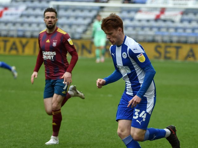 Luke Robinson in action for Latics against Ipswich