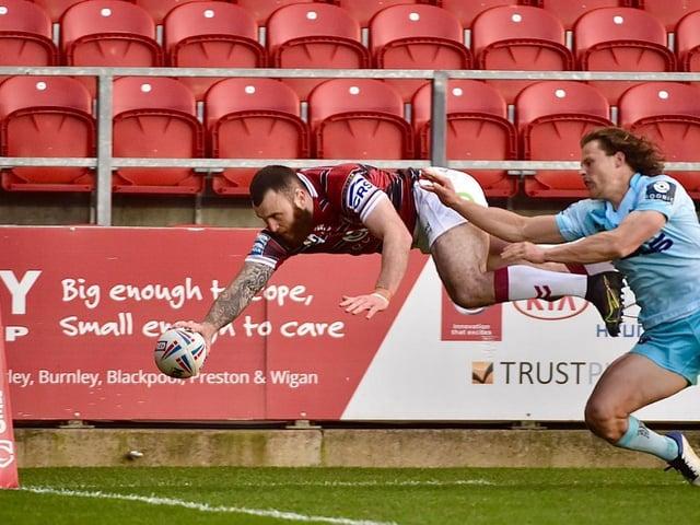 Jake Bibby flies over
