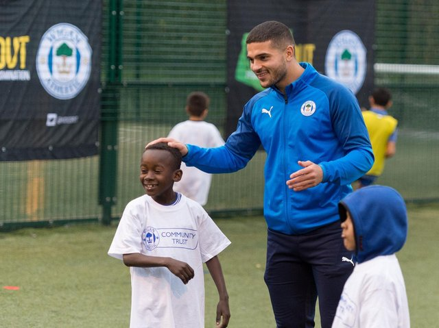 Community investment fund wigan athletic football fidelity netbenefits fidelity investments ibm