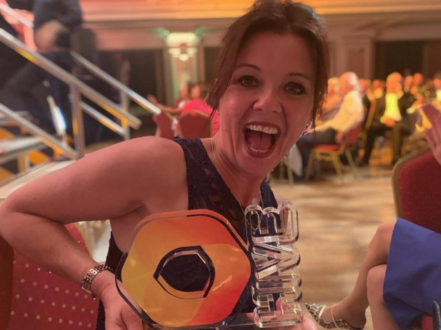 Lisa with her Hive Award