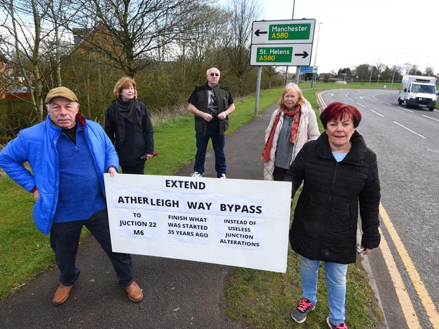 Campaigners holding a placard calling for the bypass to be extended