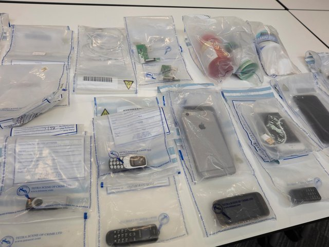 Items seized by police (Image: GMP)