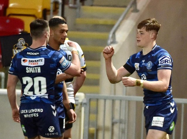 Sam Halsall celebrates his try with Harry Smith and Umyla Hanley