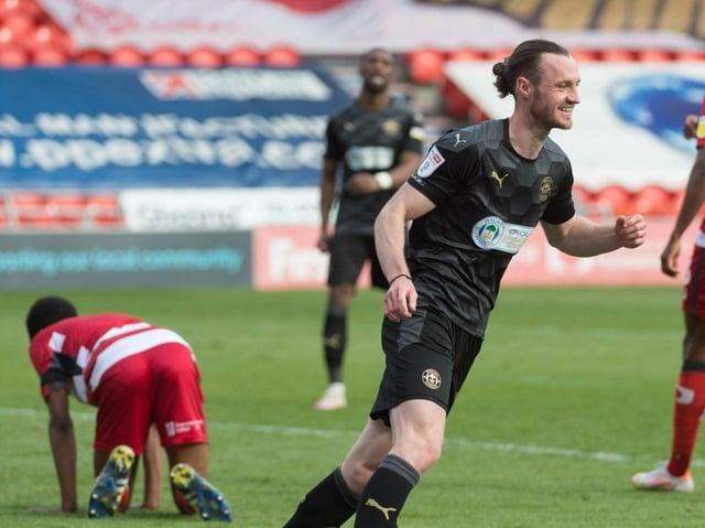 Will Keane celebrates scoring the fourth goal