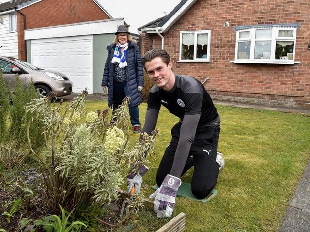 Latics player Tom Pearce and lifelong fan Bernie Green