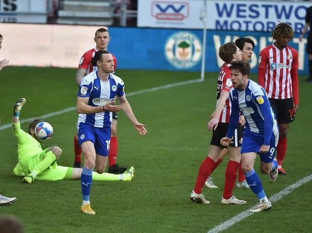 Will Keane celebrates scoring Wigan's first goal