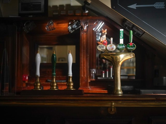Beer pumps sit dormant in a pub during the pandemic lockdown in March.