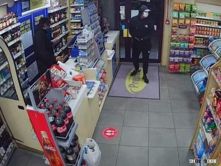 Police want to identify this man after a shop robbery in Wigan