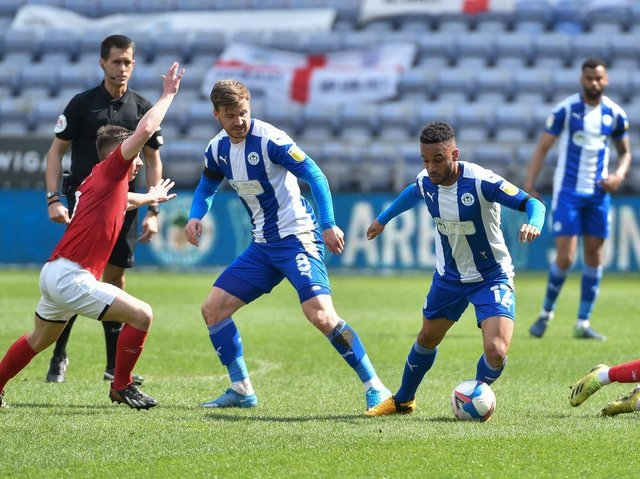 Lee Evans and Funso Ojo dominate the midfield against Crewe