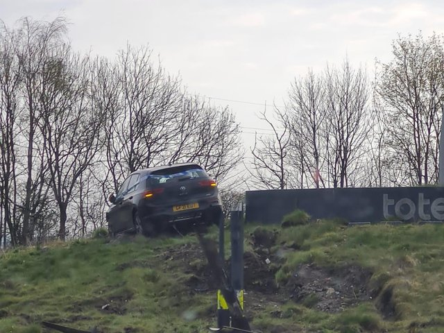 The car on top of the roundabout