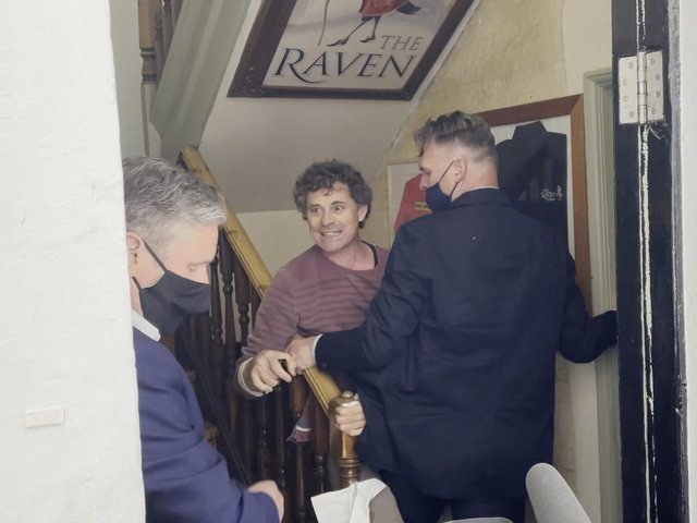 Screengrab taken from PA video of Rod Humphris (centre) landlord of the Raven pub grapples with a member of Keir Starmer's team after refusing entry to the Labour leader