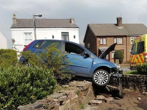 The car in the bushes after the crash outside The Stag Garswood, Station Road