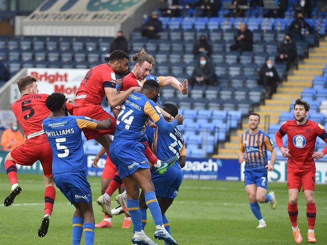 Will Keane heads home the opening goal at Shrewsbury