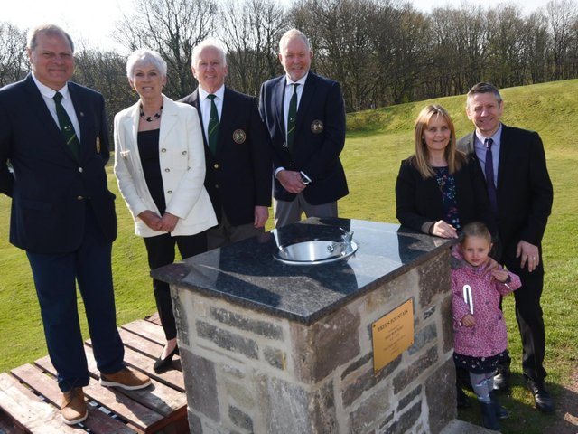 Members of the golf club's committee and Fred Burchall's family at the fountain